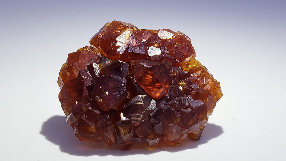 Spessartine Garnets on Hematite from Wushan Mine