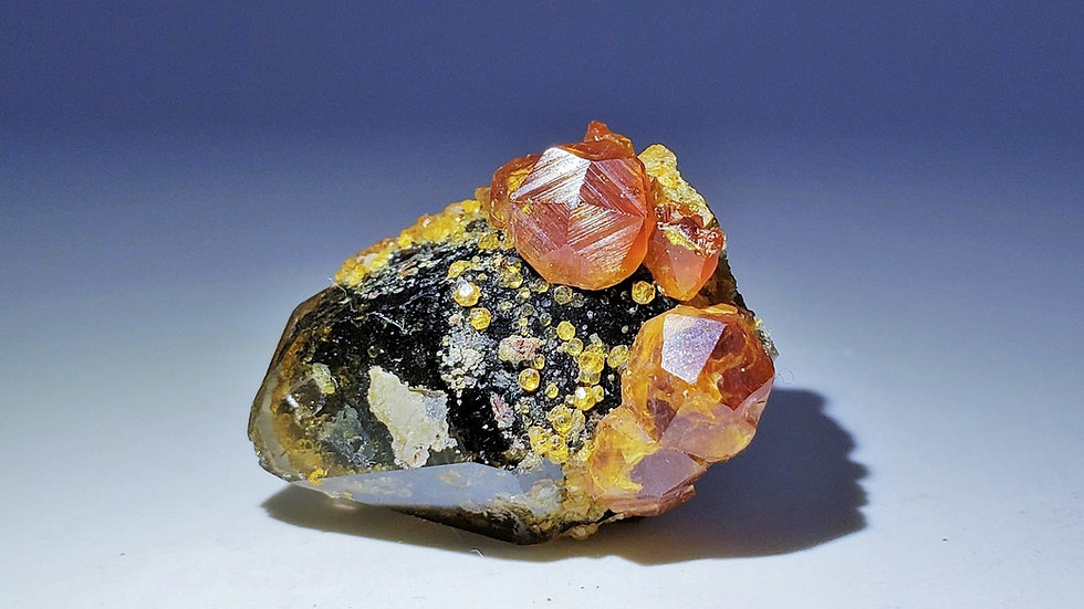 Spessartine Garnet on Smoky Quartz from Wushan Mine, China
