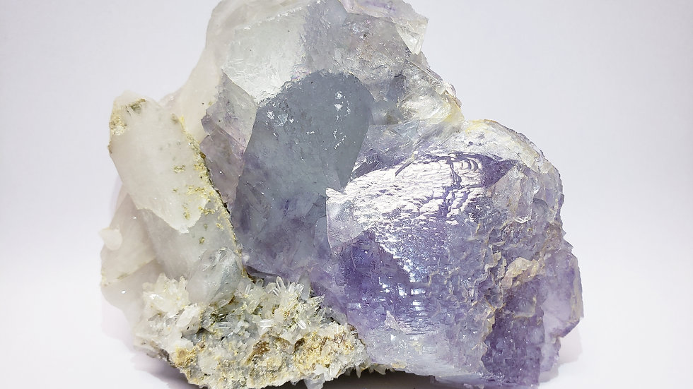 Bi-color Phantom Fluorite, Quartz and Muscovite on Matrix