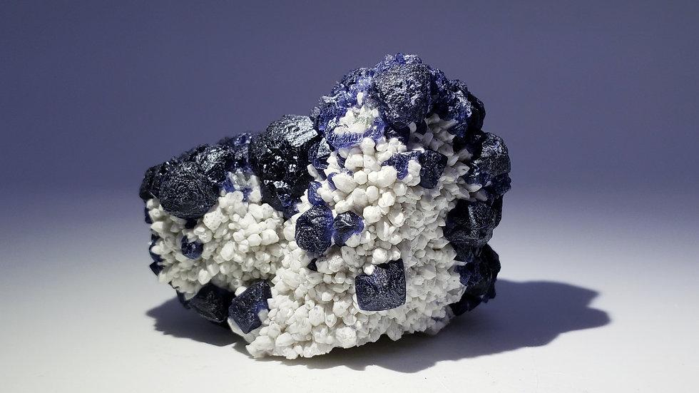 Inky Blue Fluorite on Milky Quartz from Huanggang Mine, Inner Mongolia