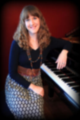 HealingMelodies.ca | Melissa Dittrich David sits next to a piano