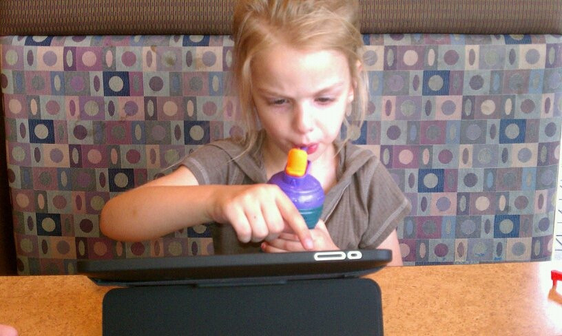 The old days with her sippy straw cup!