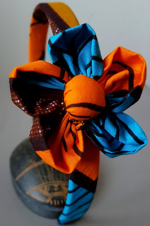 Le Serre tête avec une fleur collection Afrique Marron