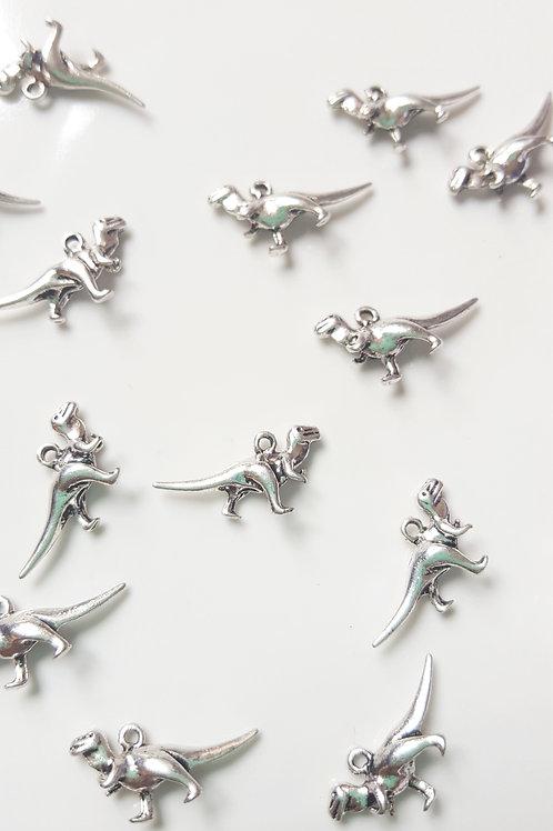 Breloque petit dinosaure en métal argenté