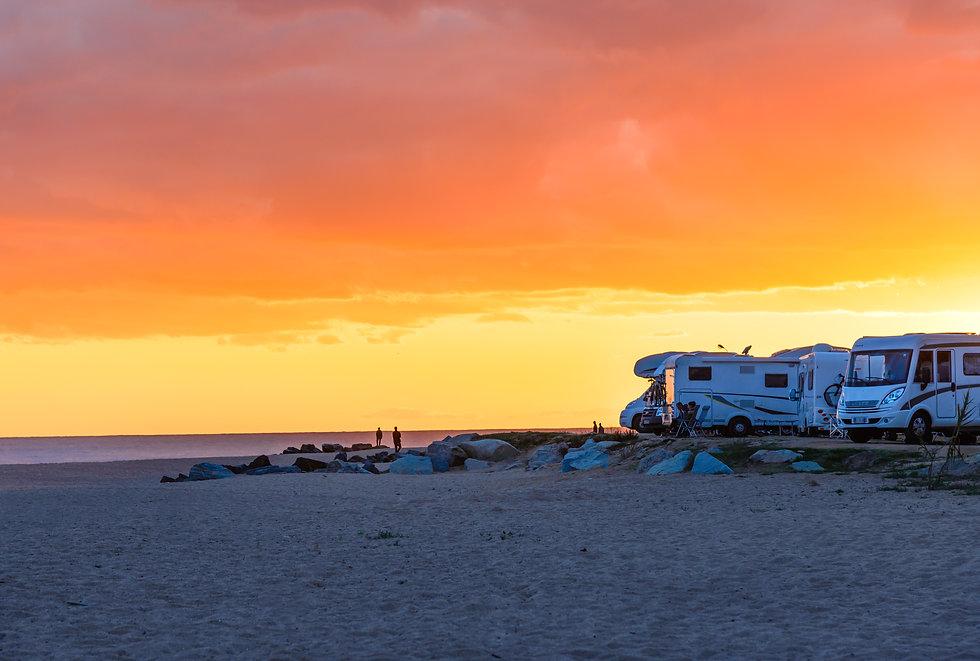 Motor homes, camper vans at sunset beach