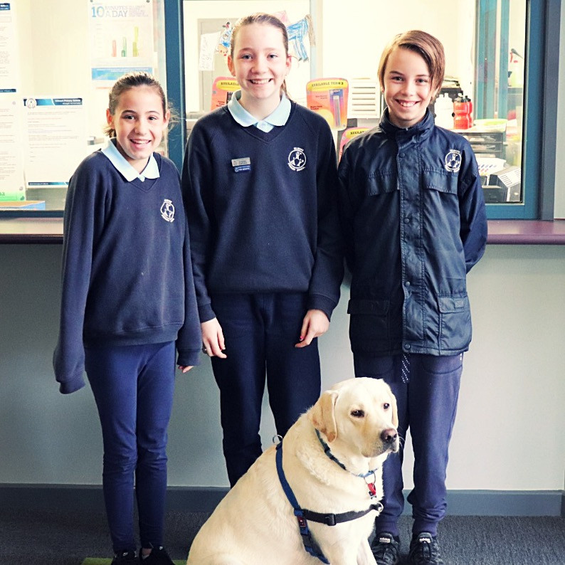 Kilmore Primary School captains Gemma, Matt and vice captain Holly with school dog, Asha
