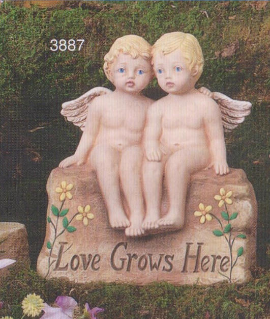 LOVE GROWS HERE CHERUBS ON ROCK & WING A