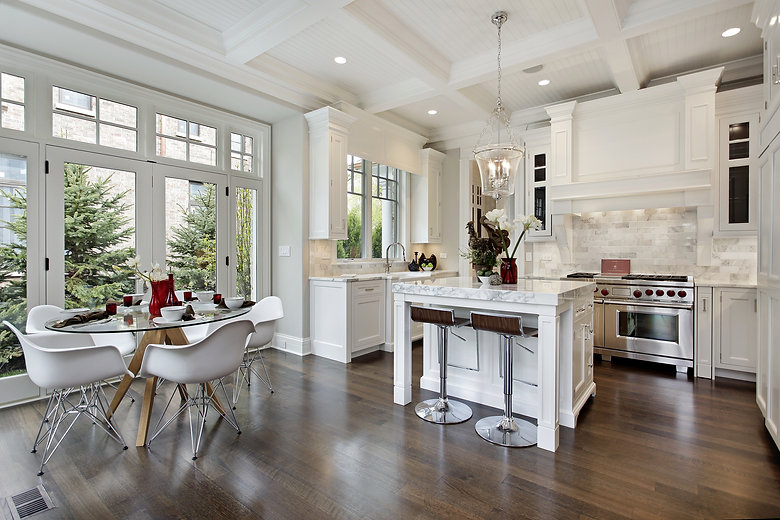 Kitchen in luxury home with white cabinetry..jpg