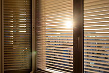 to protect against heat and sun blinds are attached to a window..jpg