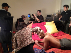 Kee on bed with crew
