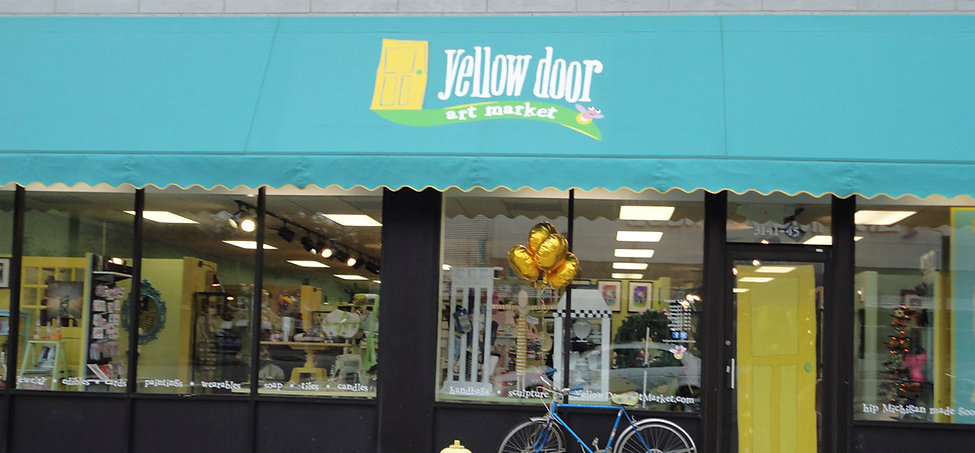 yellow door storefront.jpg