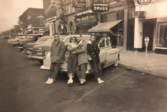 A group of young individuals hanging out on 6th Street of Downtown Nevada, Iowa