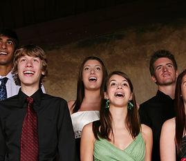 diverse group of teens singing.jpg