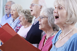 Group Of Seniors Singing In Choir Togeth