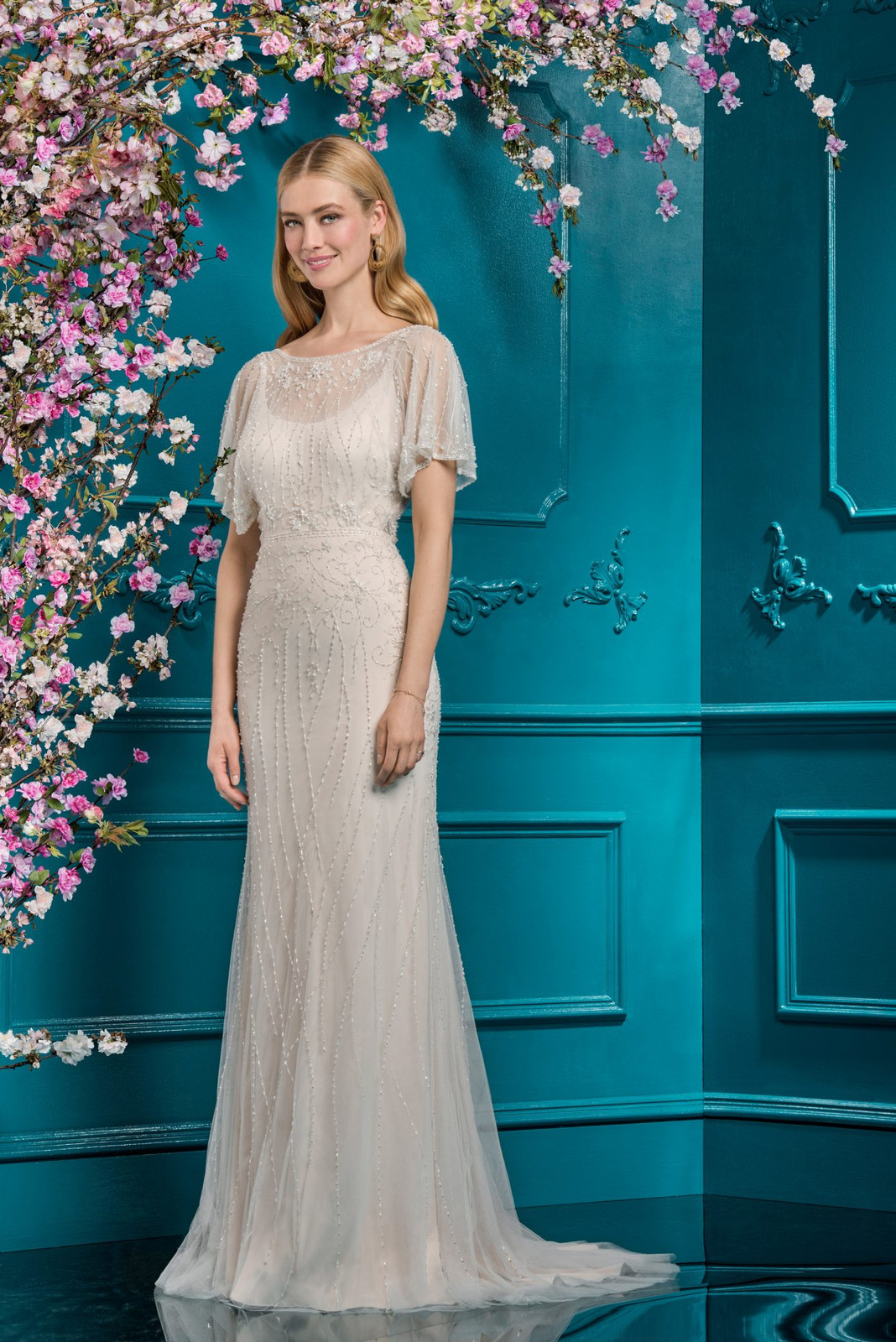d826fd009 Modern and irrefutably glamorous, a dress this magical deserves to be  loved. With unique angel sleeves and vintage-inspired beaded detailing, ...