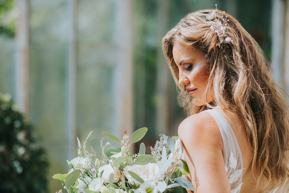 Blond bride wearing floral hair comb