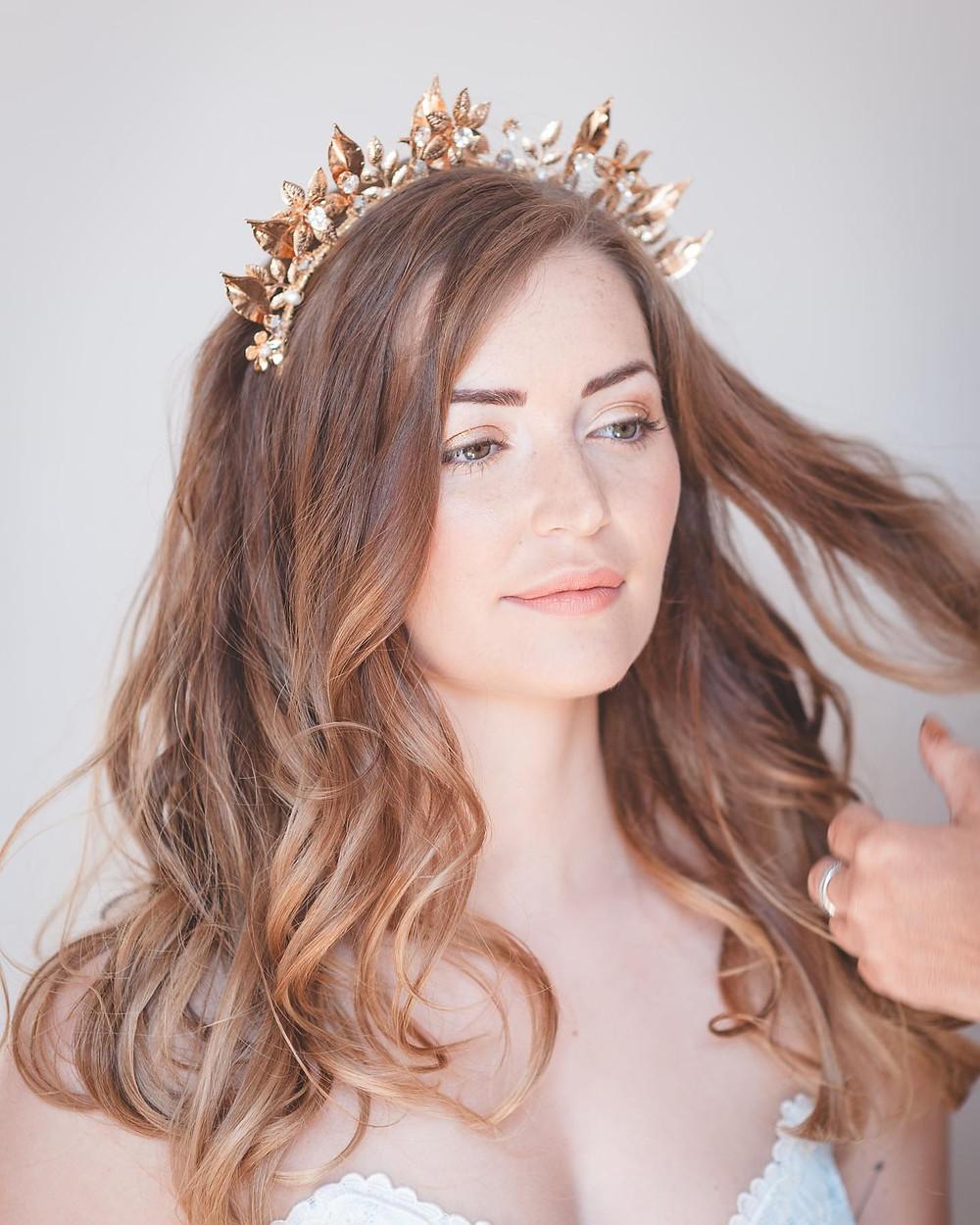 Brunette bride wearing gold bridal crown