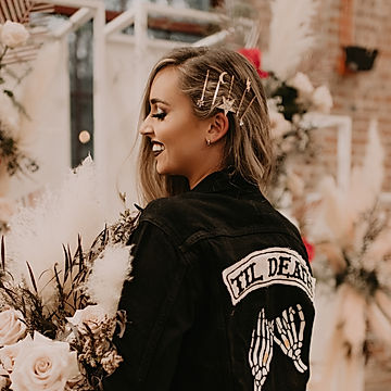 Rock and Roll bride wears gold star hair pins