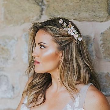 Bride wearing floral bridal hair comb