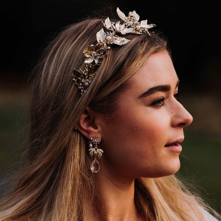 Blond bride wearing gold bridal crown