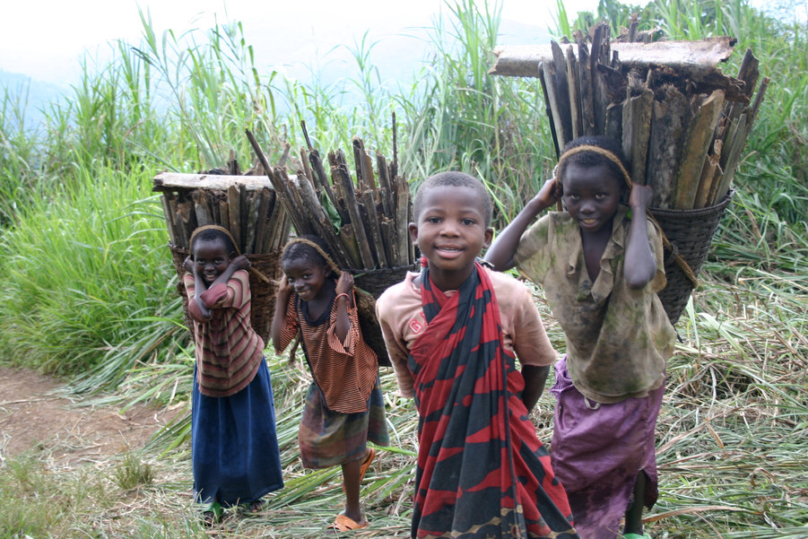 Kids walking past one of our clinics in DRC
