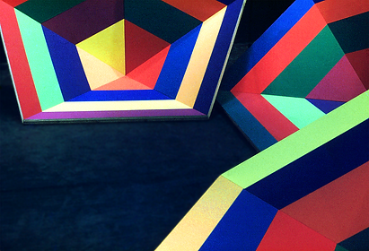 Three chromatic couloured hexagons awaiting installation