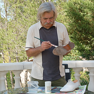 AMA painting his white shoes white