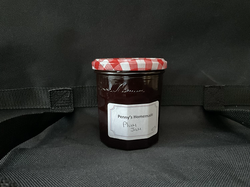 X Plum Jam made by Penny Russell in 1/2 pound and 1 pound jars