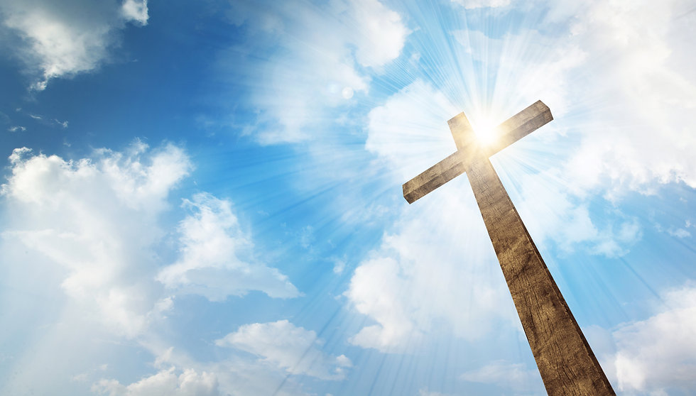 a-wooden-christian-cross-with-bright-sun