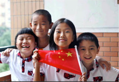 Beautiful Chinese children holding the flag of China