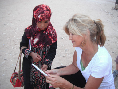 Norine Rae in Jordan talking with a young Muslim girl