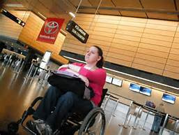 A handicapped women waiting at the airport