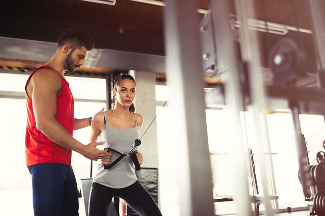 personal-trainer-helping-A6PXBEC.jpg