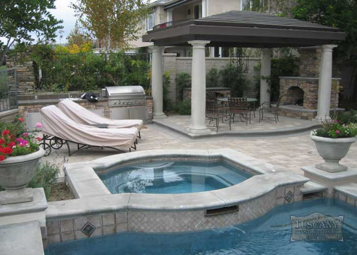 Tuscany_Landscaping_Pool_jacuzzi_BBQ_Hardscape_water_feature_fountain_Traverntine_Granite_counter_fi