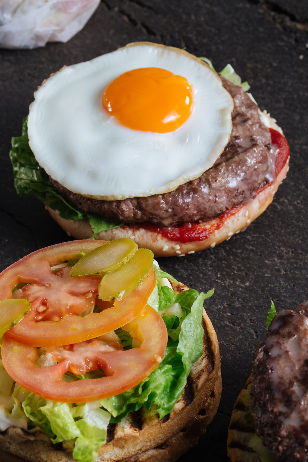 Hamburger with fried egg, fast food can lead to obesity