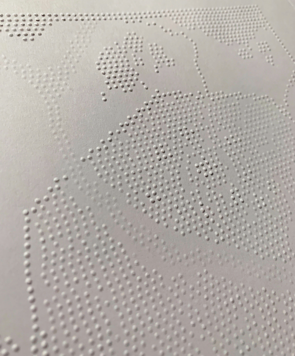 Map embossed with dots at varying heights.