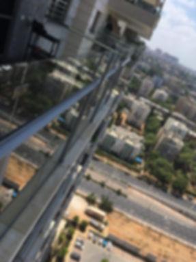ניקוי חלונות מרפסת שמש - שקוף
