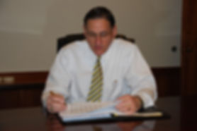 City Manager reviewing paperwork