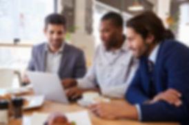 three-businessmen-having-meeting-coffee-