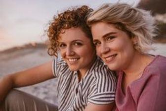 smiling-young-lesbian-couple-enjoying-ro