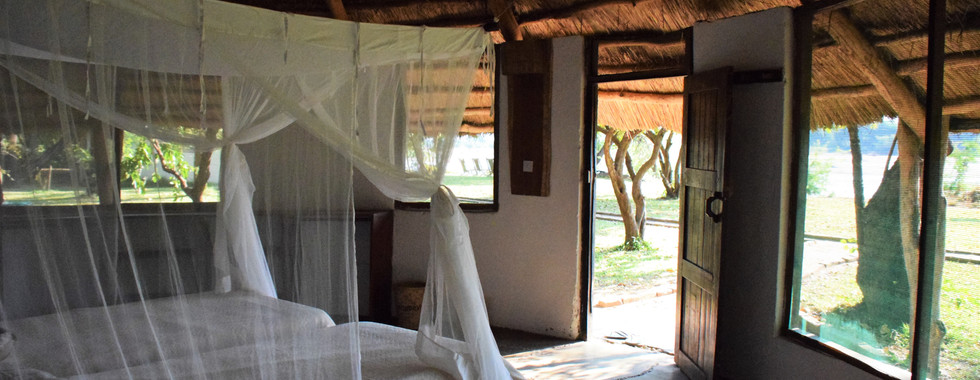 One of the Classic Rondavels set up with two single beds looking out onto the Luangwa River