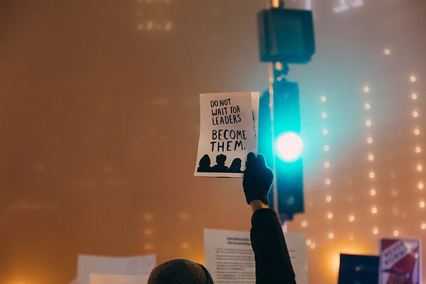 someone holding up a sign that says Do Not Wait for Leaders, Become Them.jpe