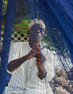 Fisherman reparing nets, Chwaka