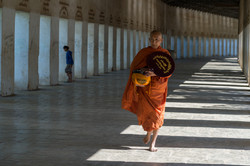 Elderly monk after the morning alms