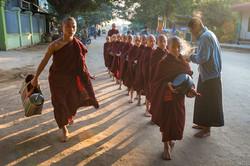 Monks gathering morning alms