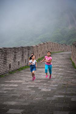 Children running - Great Wall, China
