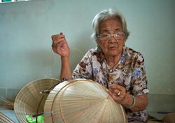 Making conical hats, Nha Trang