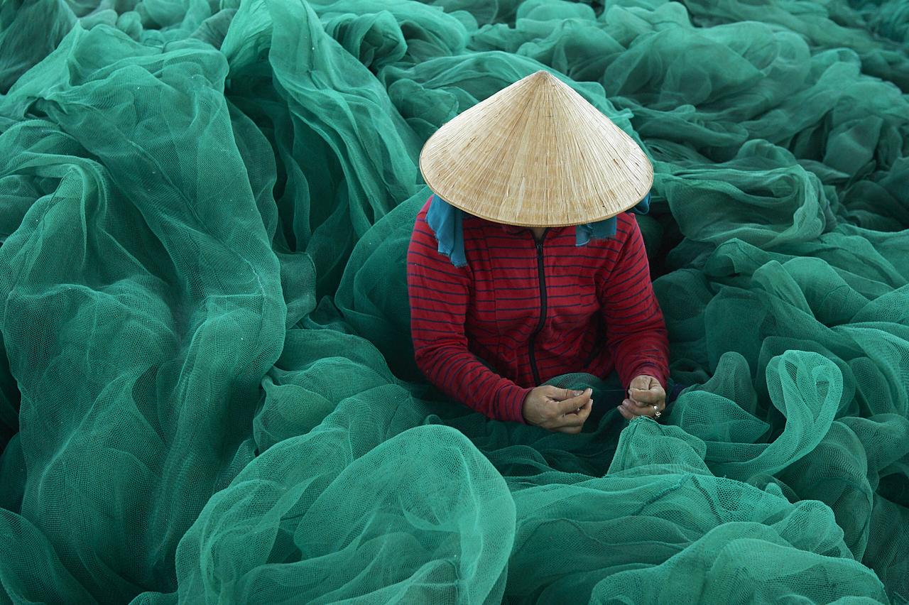 Repairing fishing nets, Nha Trang