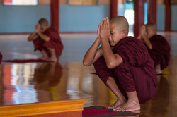 Novices pray before having lunch