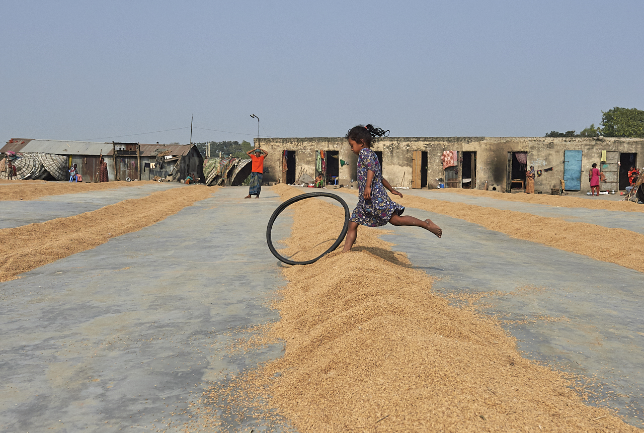 Girl playing in rice factory